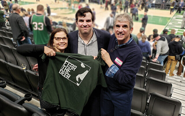 Daniel Marks and his parents, Ellen and Bill, are at a Milwaukee Bucks playoff game; Daniel works for the team. (Daniel Marks)