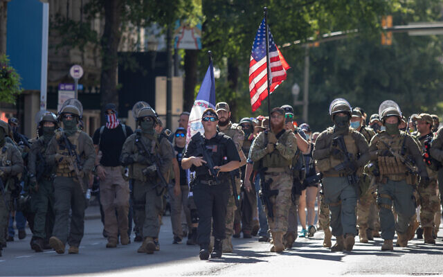 Armed gun rights protesters, led by a member of the far-right Boogaloo boys, march in Richmond, Virginia, Aug. 18, 2020. (Chad Martin/LightRocket via Getty Images)