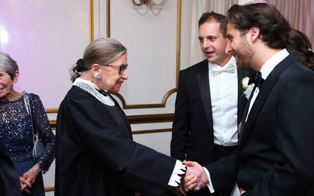 Justice Ruth Bader Ginsburg shakes hands with the author, Rabbi Avram Mlotek, at an Orthodox Jewish wedding in 2016. (Courtesy of Mlotek)