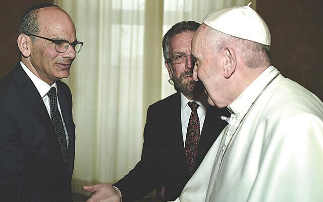 Rabbi Noam Marans shakes hands with Pope Francis as Rabbi David Rosen, the director of AJC's International Interreligious Affairs, looks on.