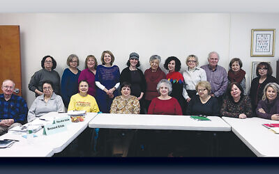 Leslie Goldress (standing, fourth from left, in blue) and her Midreshet students pose with Rabbah Sarah Hurwitz (standing, fifth from right, with a hat).