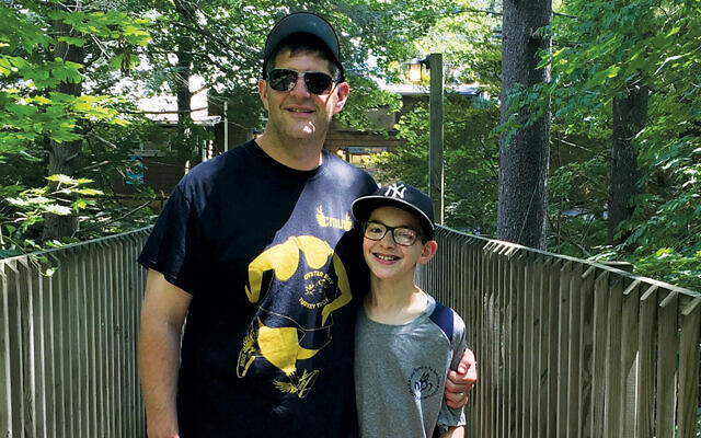 Michael Schlank and his son, Seth, at visiting day at camp a few years ago.