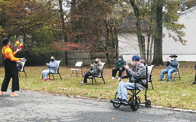 'Krazy Kevin' entertains group home residents. (Courtesy JSDD)