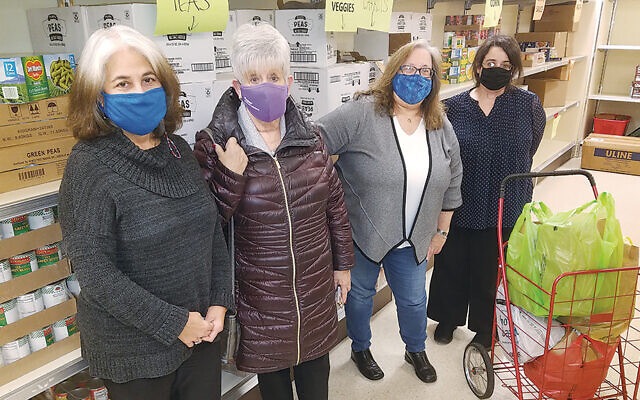 From left, Linda Griffler, executive director of Oheb Shalom Congregation; Ruth Ross and Janet O. Penn, co-chairs of Temple B'nai Abraham's social action committee; and Johanna Kluger, Oheb Shalom's administrative assistant, are at the Bobrow Kosher Food Pantry.