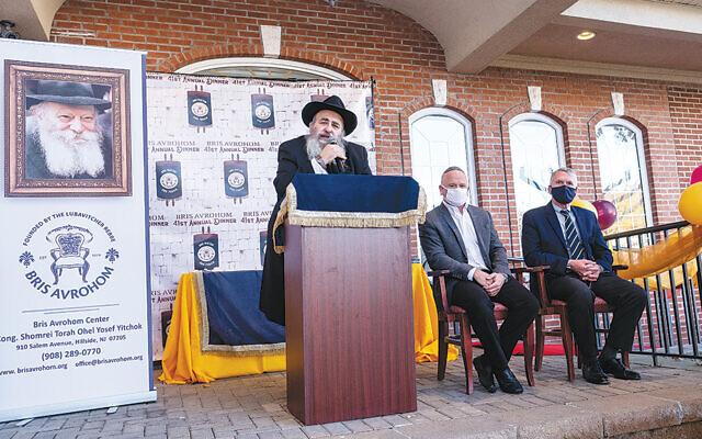 Rabbi Mordechai Kanelsky, left, with Alan Schall and Kevin Corbett