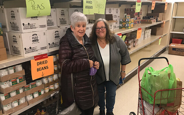 Social action committee co-chairs Roth Ross, left, and Janet Penn of Temple B'nai Abraham  are in the kosher food pantry at Oheb Shalom Congregation in South Orange.
