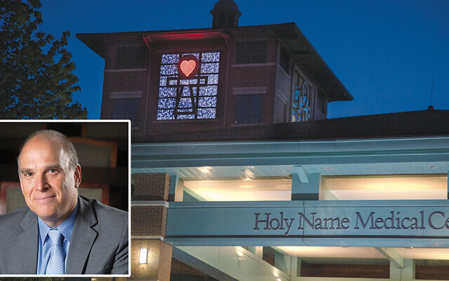Inset left, Dr. Adam Jarrett; above, the ankh above Holy Name is lit every evening. Its heart of red lights symbolizes the patients who have died of covid; the surrounding white lights, which look like stars, represent the patients who have recovered. (Photos by Jeff Rhode/Holy Name Medical Center)
