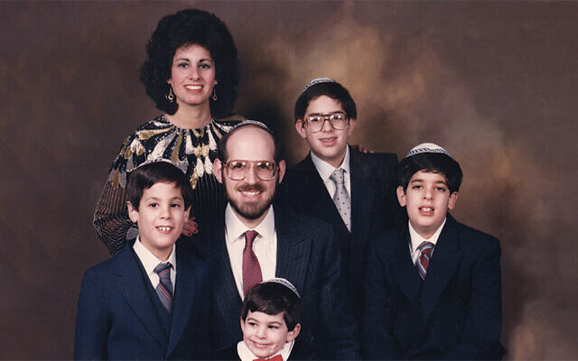 Many years ago, Linda and Rabbi Mark Karasick posed for a formal portrait with their four sons. Clockwise from the bottom, the boys are Yitzi, the youngest; then Avi, Zev, and Yaakov.