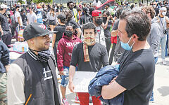 In late May, Steve Fulop, left, talked to Black Lives Matter protestors in Jersey City's Berry Lane Park. (Jennifer Brown/City of Jersey City)