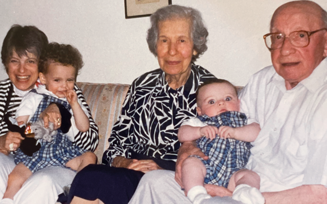 Eita Latkin holds her grandson Jack, and Bernard and Sarah Page hold Jack's brother Jonah.