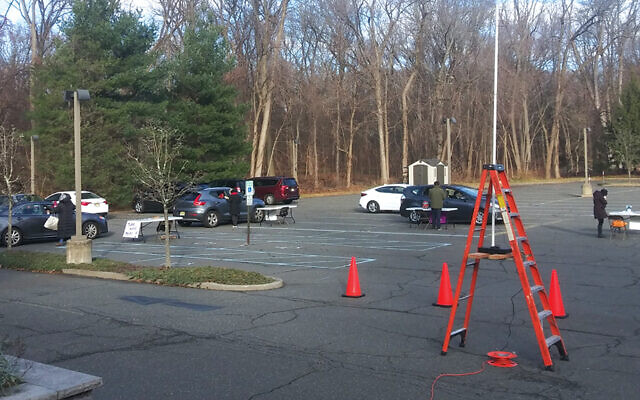 The parking lot at Temple Israel and Jewish Commuity Center in Ridgewood is set up for its Chanukah drive-in service.