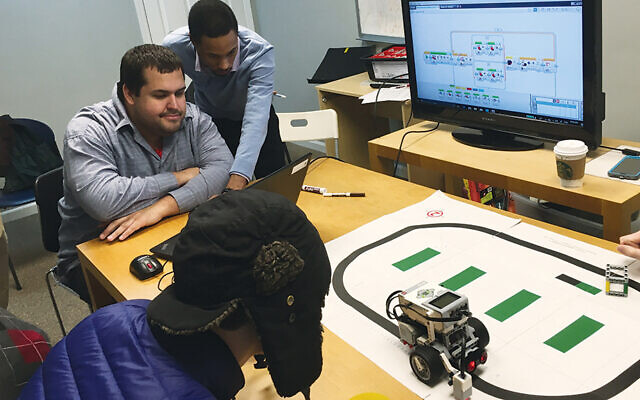 JoyDew members learn how to program a robot.