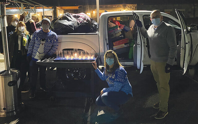Temple Emanu-El staff — from left, Mario Salazar, Chareen Kramer, Julia Vazquez, Rabbi Jeremy Fineberg, Jeanine Corrubia, and Aaron Billig — fill the truck for delivery.