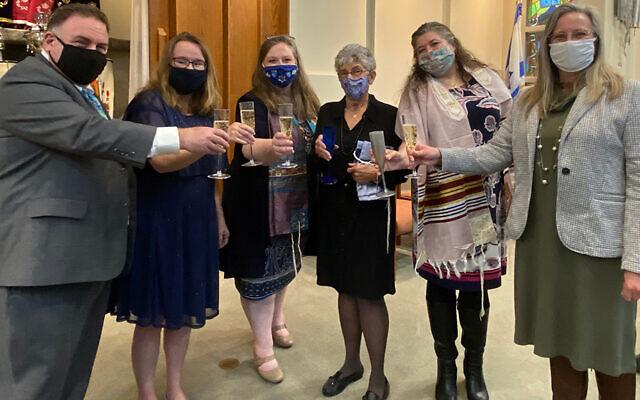 The adult Hebrew class toasts after the ceremony; from left, it's Greg Goldstein, Denise Goldstein, Lynn Anne Cutler, Ellen Dash, Dina Prasek, and Kim Levine.
