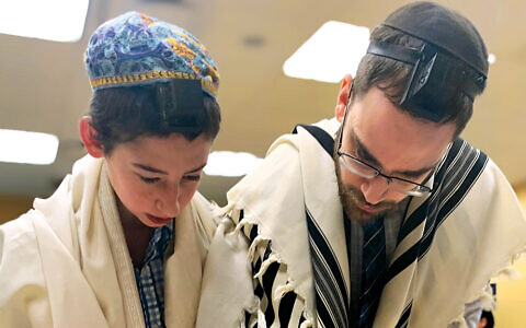 Before the pandemic last year, a teacher helps a Sinai student read Torah at TABC in Teaneck.