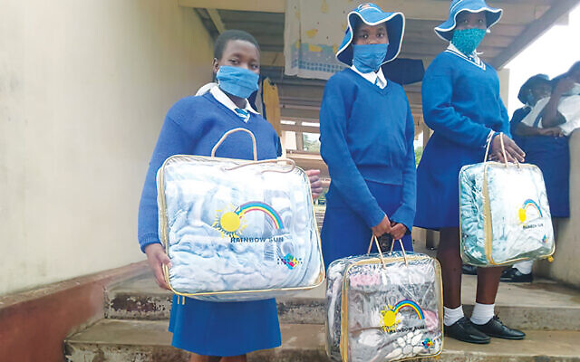 Schoolgirls in Bulawayo have just gotten their new blankets.