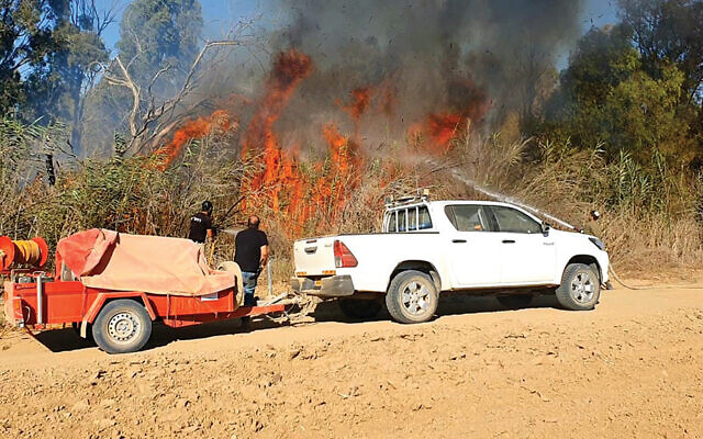 This firewagon, fighting a fire in Israel, is a gift of JNF-USA.