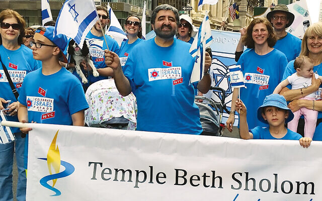 Graciela and Baruch Zeilicovich lead Beth Sholom's contingent at a recent Celebrate Israel parade on Fifth Avenue.