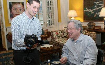 Uri Westrich works with violinist Itzhak Perlman. (Shimon Gifter)