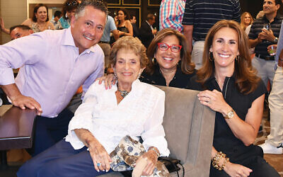 At JCC on the Palisades' 2018 Play Fore! the Kids fundraiser, Eleanor Epstein sits front and center. Surrounding her, from left: JoJo Rubach, Robin Miller, and Jodi Scherl. Ms. Scherl is now chair of the JCC's board; the other three are former presidents.