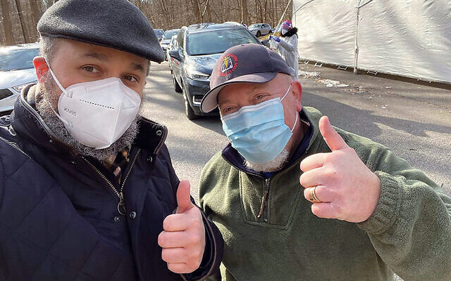 Rabbi Chanoch Kaplan and Eric Bober, owner of Fast-Med, at the site. (Courtesy Chabad)
