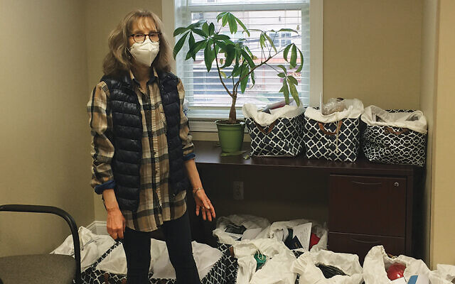 Debbie Rosenwein organizes the delivery of the baskets.