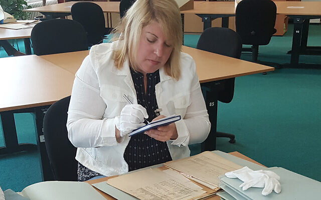 Debbie Cenziper works in an archive in Prague as she looks for information about the Trawniki men. (Courtesy Debbie Cenziper)