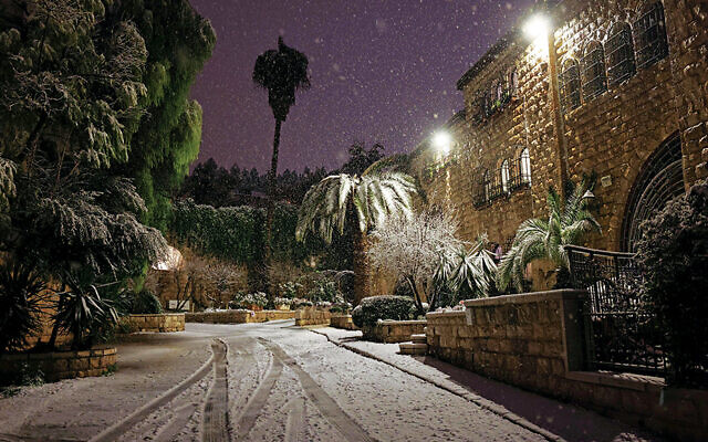 Snow covers a neighborhood in Jerusalem late on February 17, 2021. (MManuel Dunand/AFP via Getty Images)