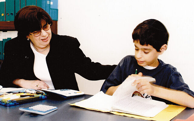 Dean Laurette Rothwachs works with a student in 2006.