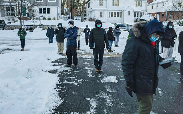 This Teaneck minyan, like many others, met outside despite the snow last week. (Orthodox Union)