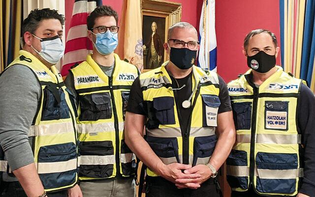 Standing, from left, in the mayor's house last month, Dr. Josef Schenker, Dr. David Kestenbaum, Englewood Mayor Michael Wildes, and Joshua Hartman hope to join Bergen Hatzalah when it is launched.