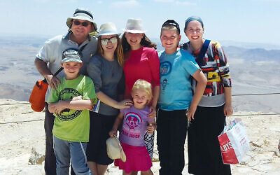Rabbi Dr. Avidan Milevsky and Dr. Ilana Milevsky with their children Liora, Tamar, Uzi, Mati, and Moriah.