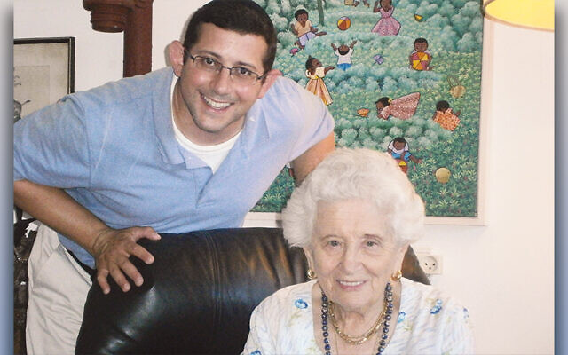 Jonathan Milgram stands behind Ruth Dayan, who died in February, just before she was to turn 104.