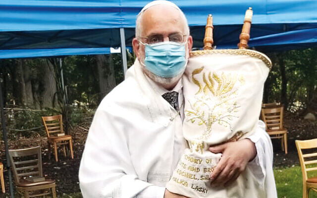 "Rabbi Prouser before Rosh Hashanah services in 2020. ""My mother always wanted me to go into a profession that requires the regular use of surgical gloves and masks,"" he said."