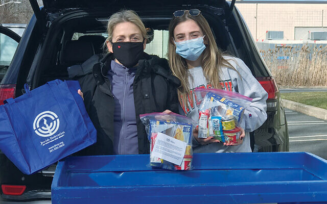 Tiffany Kaplan of Demarest, co-chair of the March Mega Food Drive, is with her daughter, Daisy.