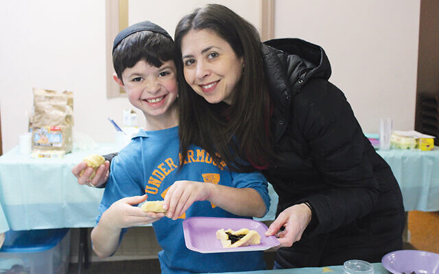 Lisa Friend and her son Jared of Woodcliff Lake participated in one of Chabad's earlier hamantash bakes. (Valley Chabad)