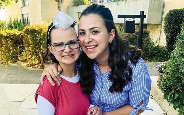 Aliza Walzman, right, with Yachad participant Rivka Kaplan during their Yad B'Yad summer.
