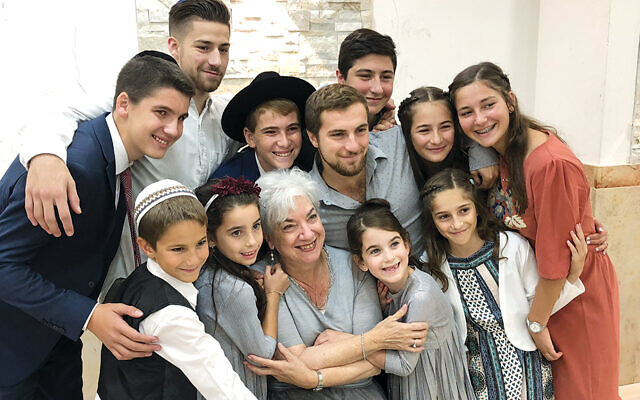 Tzivia Bieler with many of her grandchildren; they're in Israel to celebrate one of them becoming bar mitzvah.