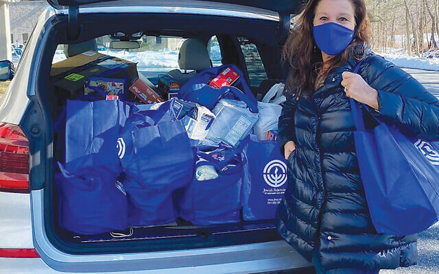 Geri Cantor of Woodcliff Lake has her car filled with food bags to bring to federation.