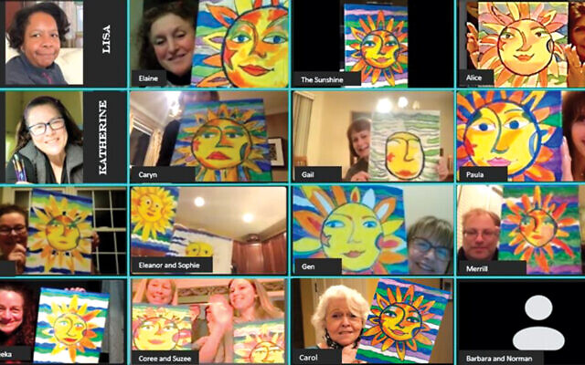 Participants show off the art they created.