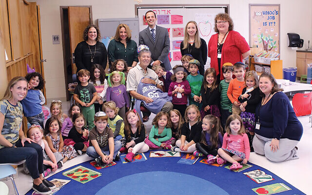 Preschoolers, kindergarteners, and their teachers celebrate Dr. Och's 85th birthday in 2016; Dr. Och is in the center, and Adam Shapiro stands behind him.