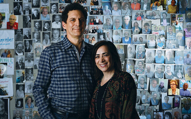 John and Amy Pregulman stand in front of a wall of John's photos of Holocaust survivors; four of those surviviors — none of whom get help from Kavod — are below. The Pregulmans prefer not to provide survivors' names.