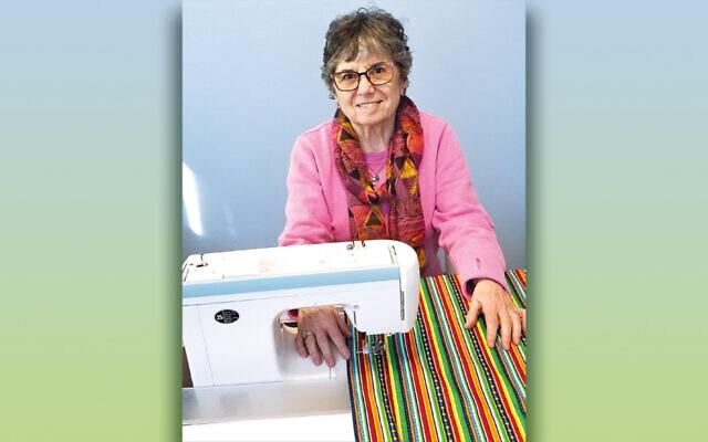 Belle Schwartz and her sewing machine.