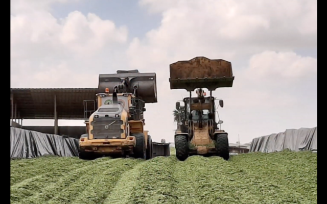 Farm equipment at Ein Hashlosha, a kibbutz on Israel's border with Gaza that has seen a recent influx of young families. (Screenshot from YouTube)