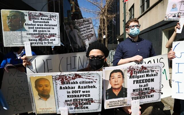Protesters against China's policies toward the Uighurs demonstrate outside United Nations headquarters in New York City, March 22, 2021. The protester in the foreground is wearing a kippah. (Tayfun Coskun/Anadolu Agency via Getty Images)