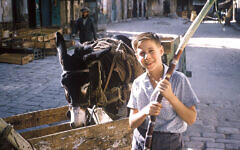 Barry Wadler and a donkey are in Jerusalem in 1961.