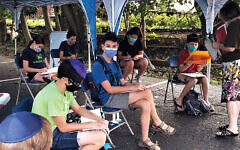 The Glen Rock Jewish Center's Zayin class works outdoors. (All photos courtesy GRJC)