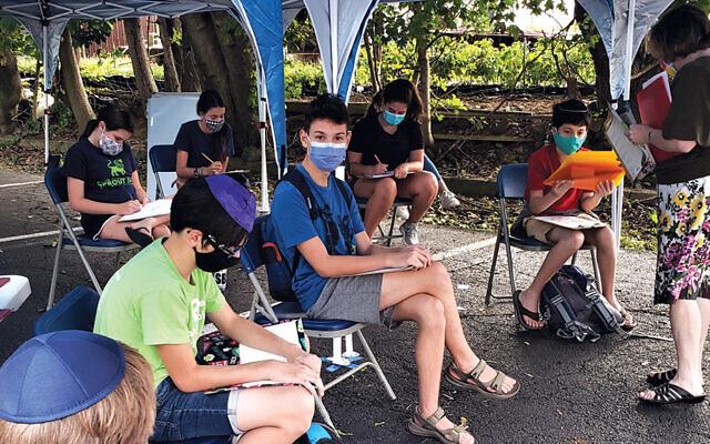 The Glen Rock Jewish Center's Zayin class works outdoors. (All photos courtesy GRJC)