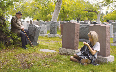 "Edward Asner and Margot Josefsohn's characters meet in a cemetery in ""Tiger Within."""