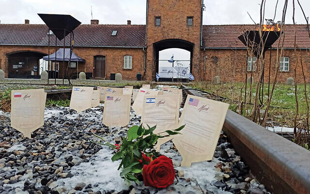 Virtual plaques on the Auschwitz-Birkenau train tracks